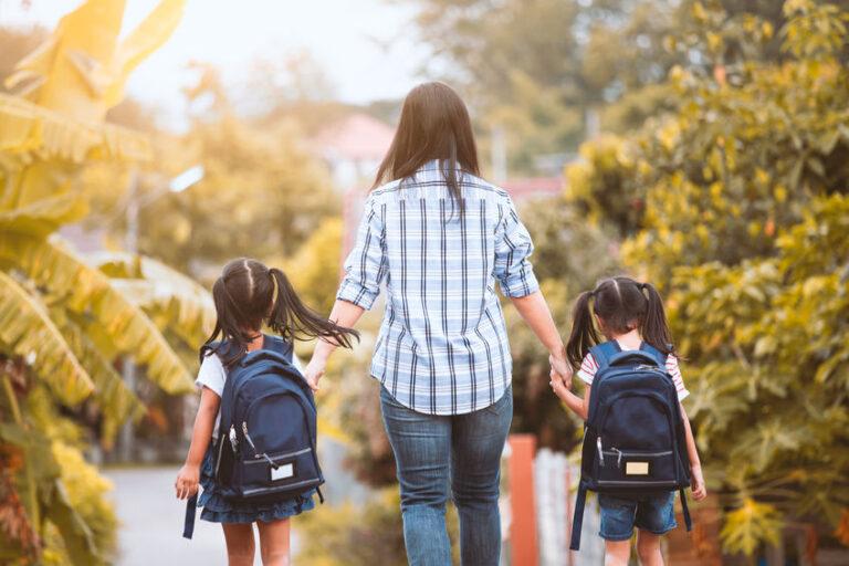 Mother and school children