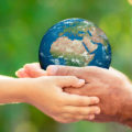 Hands holding globe - Inner West Mums Climate Change Challenge
