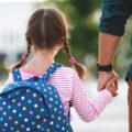 Young girl walking to school