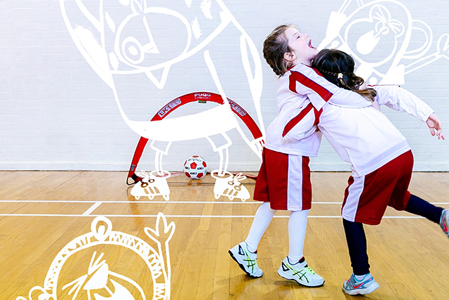 Little Kickers - two children hugging