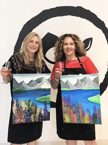 Inner West Mums team holding finished paintings