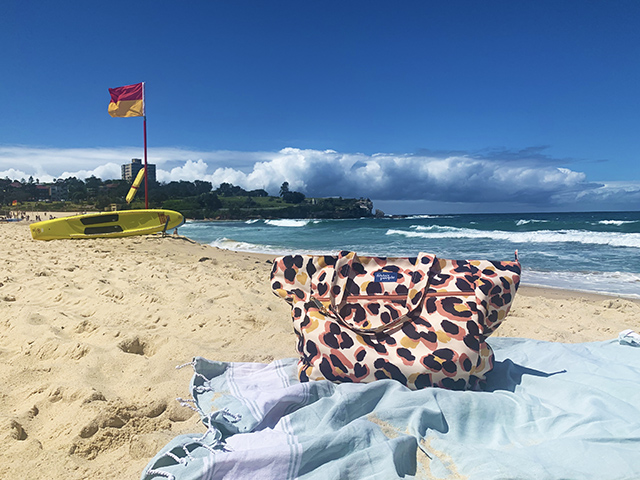 The Friday People tote bag on Coogee beach