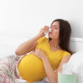 Pregnant woman in bed with a cold