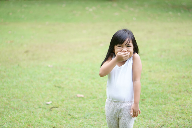 Kid girl stand smile with laugh and hand