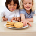 Kids eating biscuits